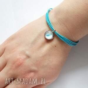 niebieskie sznureczki bransoletka - piórko