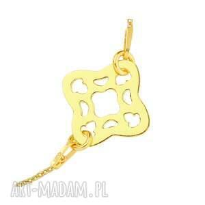 ciekawe złota bransoletka z arabską rozetką