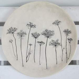 czarne ceramika roślinny talerz z roślinami baldachami