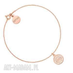 bransoletka z ażurową rozetką z różowego złota