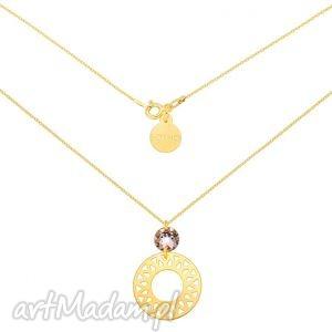 złoty naszyjnik z dużą arabską rozetą i cielistym kryształem