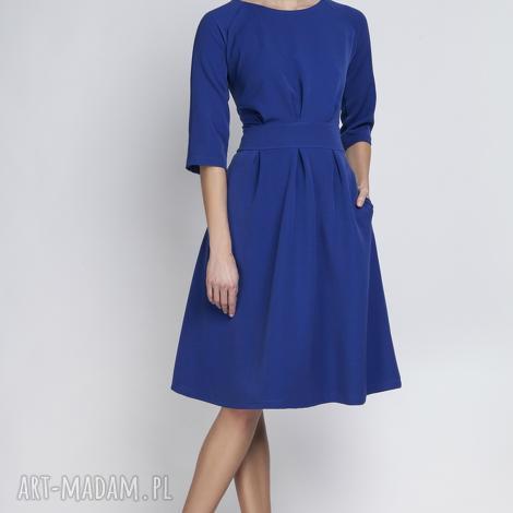 sukienka z rozkloszowanym dołem, suk122 indygo, rozkloszowana, kieszenie, taliowana