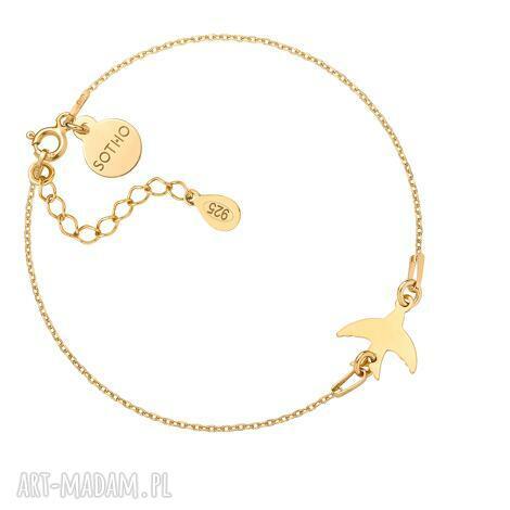 złota bransoletka z jaskółką, bransoletka, zawieszka, ptak, łapana, zwierzęta