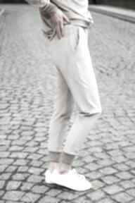 Modne gładkie spodnie dresowe welurowe kolor beż lona sportowe
