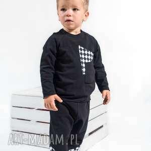 spodnie z obniżonym krokiem czarne rombami , moda ubranka dla dziecka
