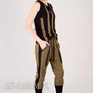 spodnie z aplikacja dzianiny, aztec, wzorek, dzianinowe, metaliczne, nadruk