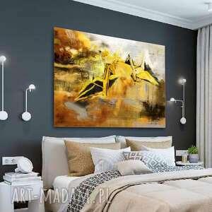 obraz na płótnie spotkanie w przestrzeni 120x80, złote, nowoczesne