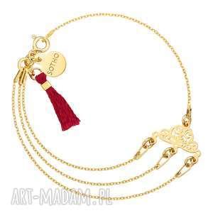 Złota bransoletka z rozetką i bordowym chwostem, bransoletka, rozetka, chwost