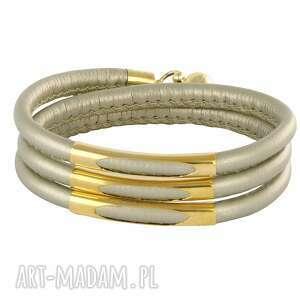 bracelet in metalik beige gold , rzemień, rurka, magnes biżuteria
