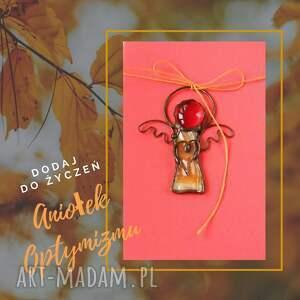 kartka na życzenia z wesołym aniołkiem optymizmu, życzenia