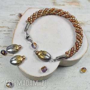 komplety oryginalny komplet biżuterii - bransoletka z koralików i kolczyki skarabeusz