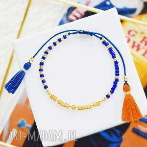 handmade bransoletka na sznurku z chwostami granatowo-pomarańczowa minimal orange and