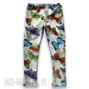 motyle kremowo-szare legginsy z kolorowymi motylkami, spodnie dla dziewczynki