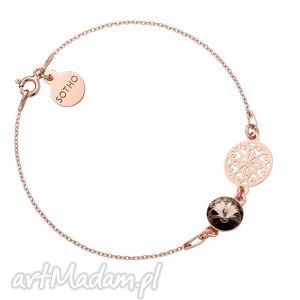 bransoletka z różowego złota z rozetą i kryształem