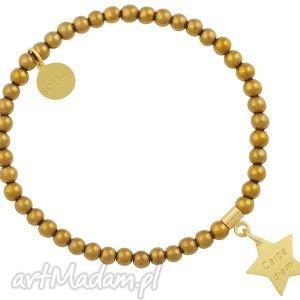 złota bransoletka modowa z hematytu ze złotą gwiazdką carpe