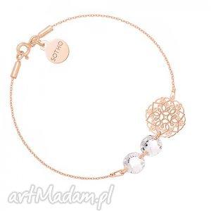 bransoletka z różowego złota z rozetką i kryształami