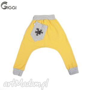 Żółte spodnie z szarymi wstawkami - puzzel r. 122-158, spodnie,