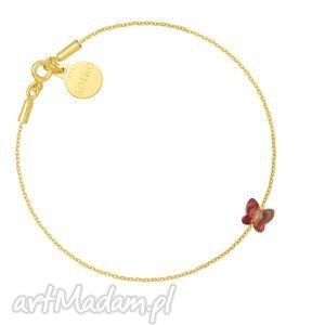 złota bransoletka zdobiona brązowym motylkiem swarovski crystal