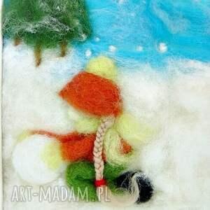 pokoik dziecka bałwan dziewczynka lepiąca bałwana. Obraz