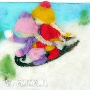 pomysł na świąteczny upominek turkusowe saneczkach. Obraz z kolekcji