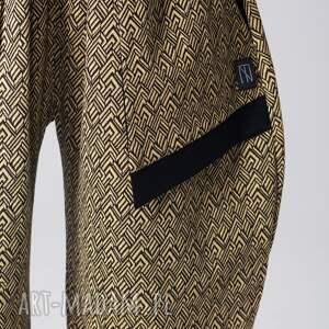 art spodnie żółte dzianinowe we wzór