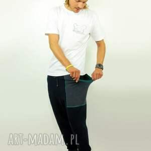 turkusowe spodnie dresowe z nisko osadzonym krokiem