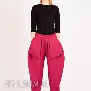 awangardowe spodnie różowe z kieszonkami