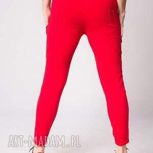 pomarańczowe spodnie fashion w kolorze czerwonym