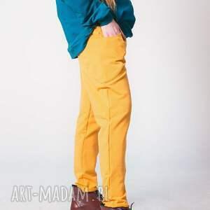 spodnie dress pomarańczowe w kolorze najmodniejszym
