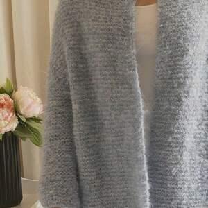 swetry wełniany niebieski kardigan