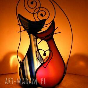 różowe świeczniki dekoracja witrażowa świecznik z kolorowymi kotami
