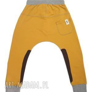 pomarańczowe spodnie baggy musztarda
