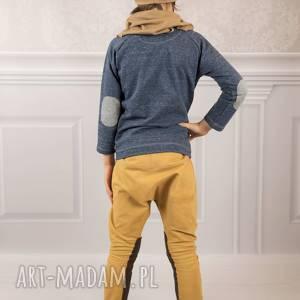 intrygujące łaty spodnie baggy musztarda
