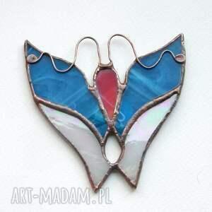 niebieskie witraże motyl fruwajek błękitny